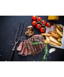 Kesu, Beef steak on stone background