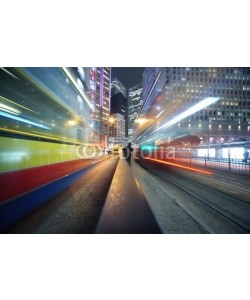 Konstantin Sutyagin, Fast moving bus lights blurred over modern city background