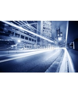 Konstantin Sutyagin, Fast moving cars lights blurred over modern city background