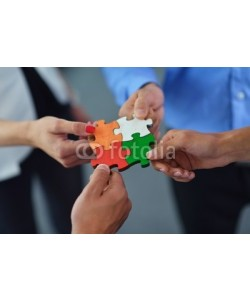 shock, Group of business people assembling jigsaw puzzle
